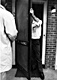 Feb, 18, 1970: CID Investigator Bill Ivory (right) and CID Fingerprint Examiner Hilyard Medlin (left) examine the utility room screen door of 544 Castle Drive