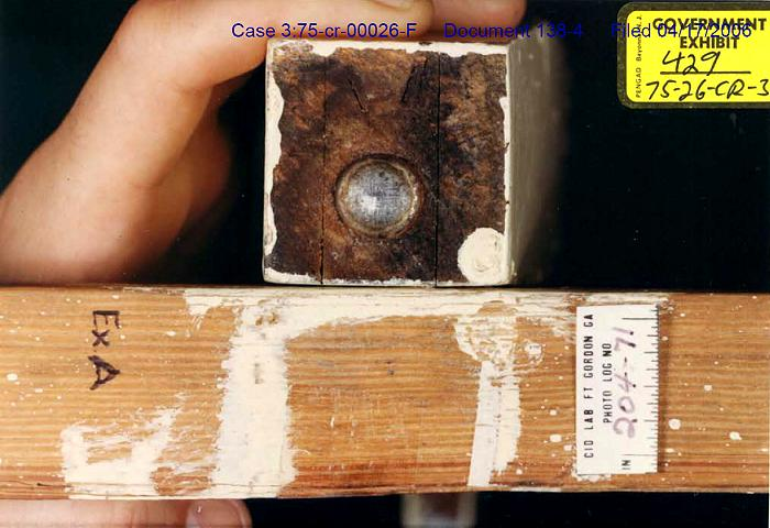 Exhibit A: Comparison of paint stains<br><br><em>Webmaster note:</em> The piece of wood being compared to Exhibit A is a leg of the headboard from the bed in the south bedroom (Kimberly).