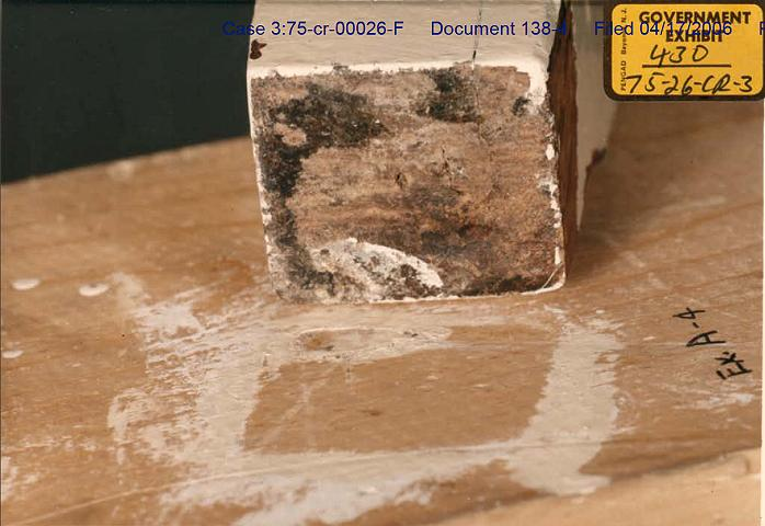 Exhibit A4: Comparison of paint stains<br><br><em>Webmaster note:</em> The piece of wood being compared to Exhibit A4 is a leg of the headboard from the bed in the south bedroom (Kimberly).
