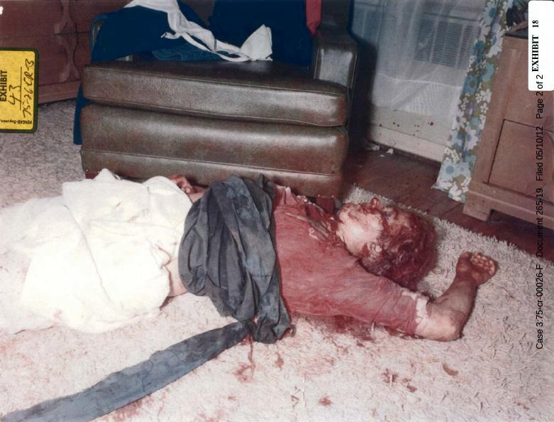 Body of Colette MacDonald in east bedroom (circled area near left elbow is a piece of surgical glove)